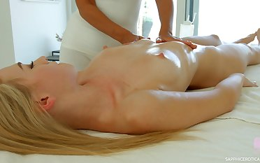 Several smoking hot girls are making love right on the massage embark on