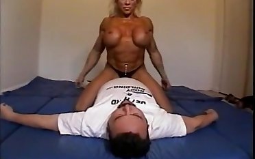 Unclad female bodybuilder dominates male with scissors, facesits, pest smothers with the addition of breast