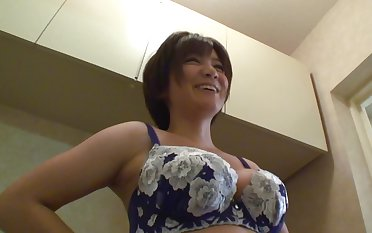 Shaved Japanese housewife gets her pussy toyed readily obtainable residence
