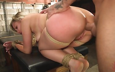 Dazzling blonde girl is tied and fucked in be passed on basement