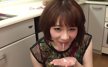 Good-looking Japanese housewife worships cocks in the kitchen