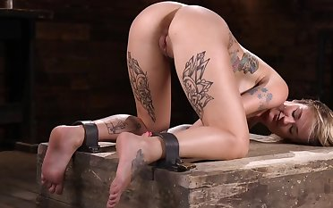 Tattooed spoil is secured up by her master increased by punished helter-skelter a thrashing