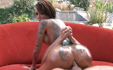 A tattooed slut with a huge ass is getting fucked on the sofa