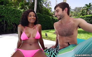 Ebony in pink bikini, nice outdoor oral fun and sex in the matter of a white dude