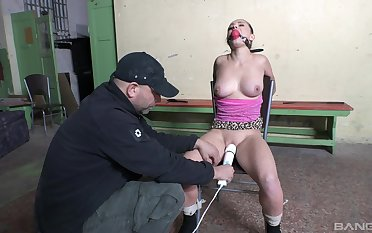 Nude girl sits gagged and demure while playing duteous