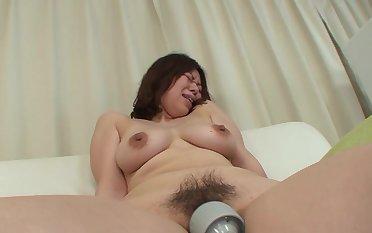Japanese MILF Haruko Ogura opens her legs to execrate pleasured