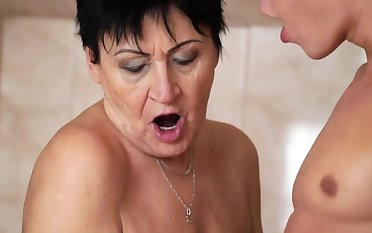 Saleable granny enjoys steamy oral session just about a younger guy