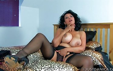 Naughty wife Danica Collins spreads her legs to tease the camera