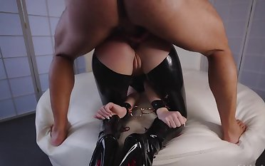 Bearded dexterous fucks juicy ass of the latex slave relating to doggystyle