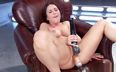 Shaved babe fucks outfit and cums
