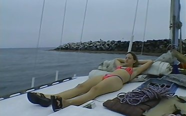 Cute girl gets her cunt filled a friend's hard cock on the yacht