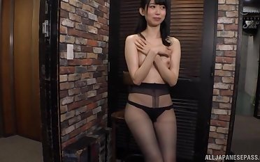 Kurokawa Sumire wears black nylon and masturbates nearly the room